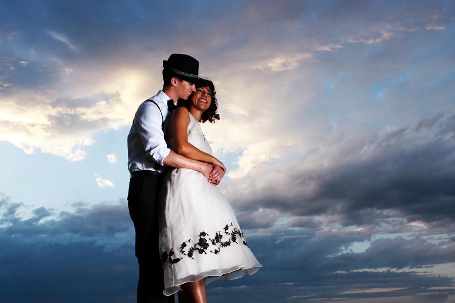 Lewisburg engagement photography.engaged couple smiling under a dramatic sky