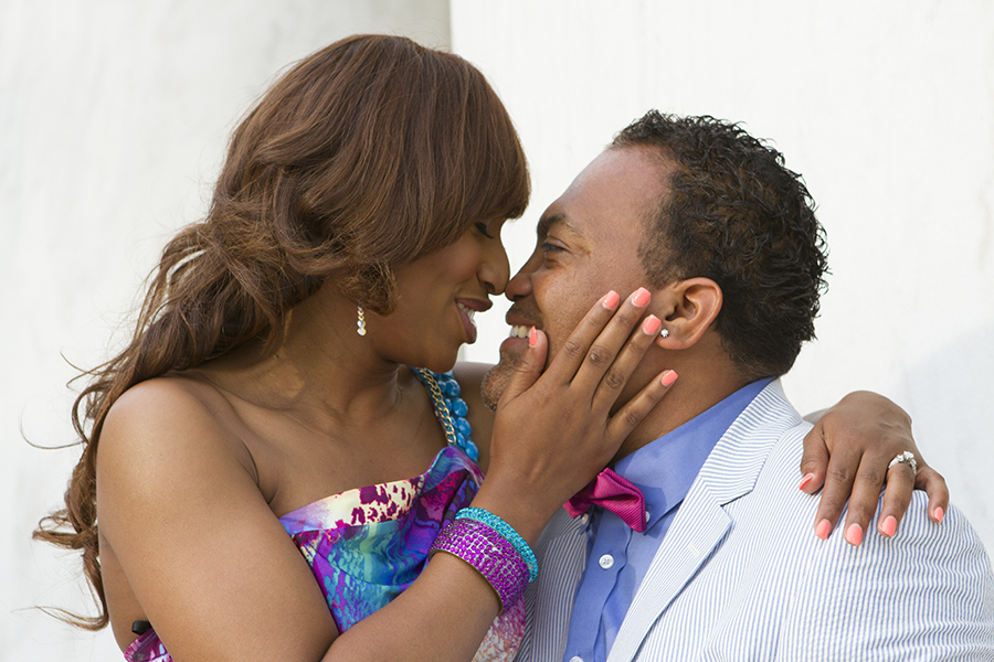 engagement photography couple with matching colors about to kiss