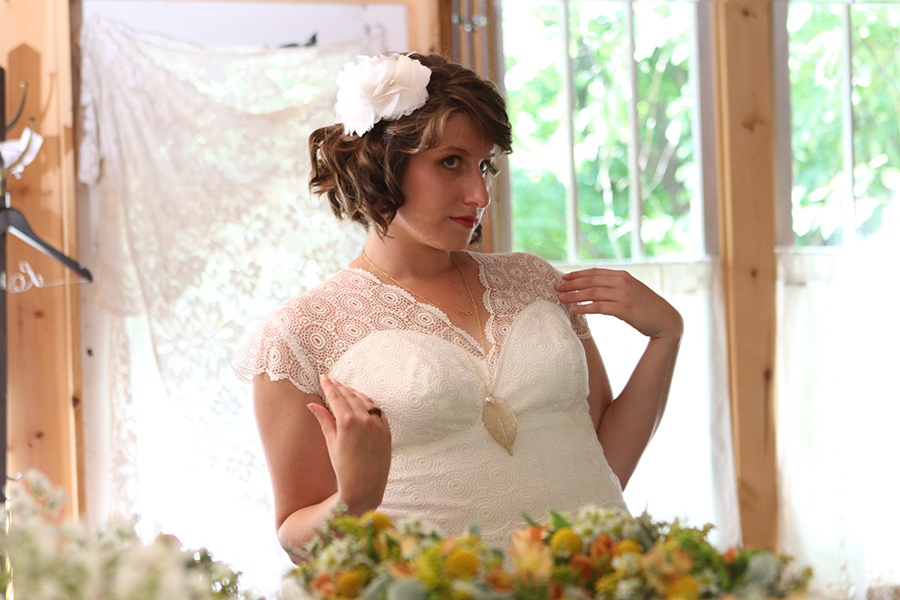 Bride looking in the mirror after getting dressed