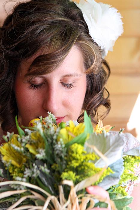 bride smelling flower bouquet