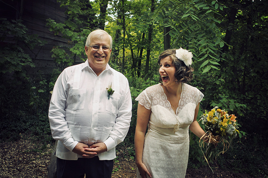 Bride and father laughing before he gives her away.