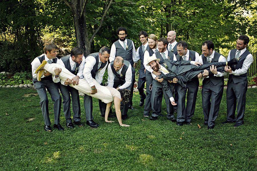 Groomsmen dropping the bride