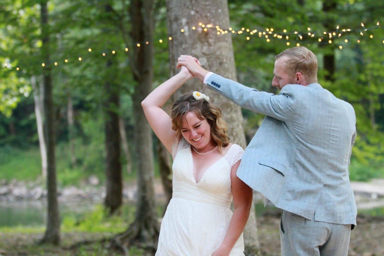 bride and groom dancing outdoor wedding