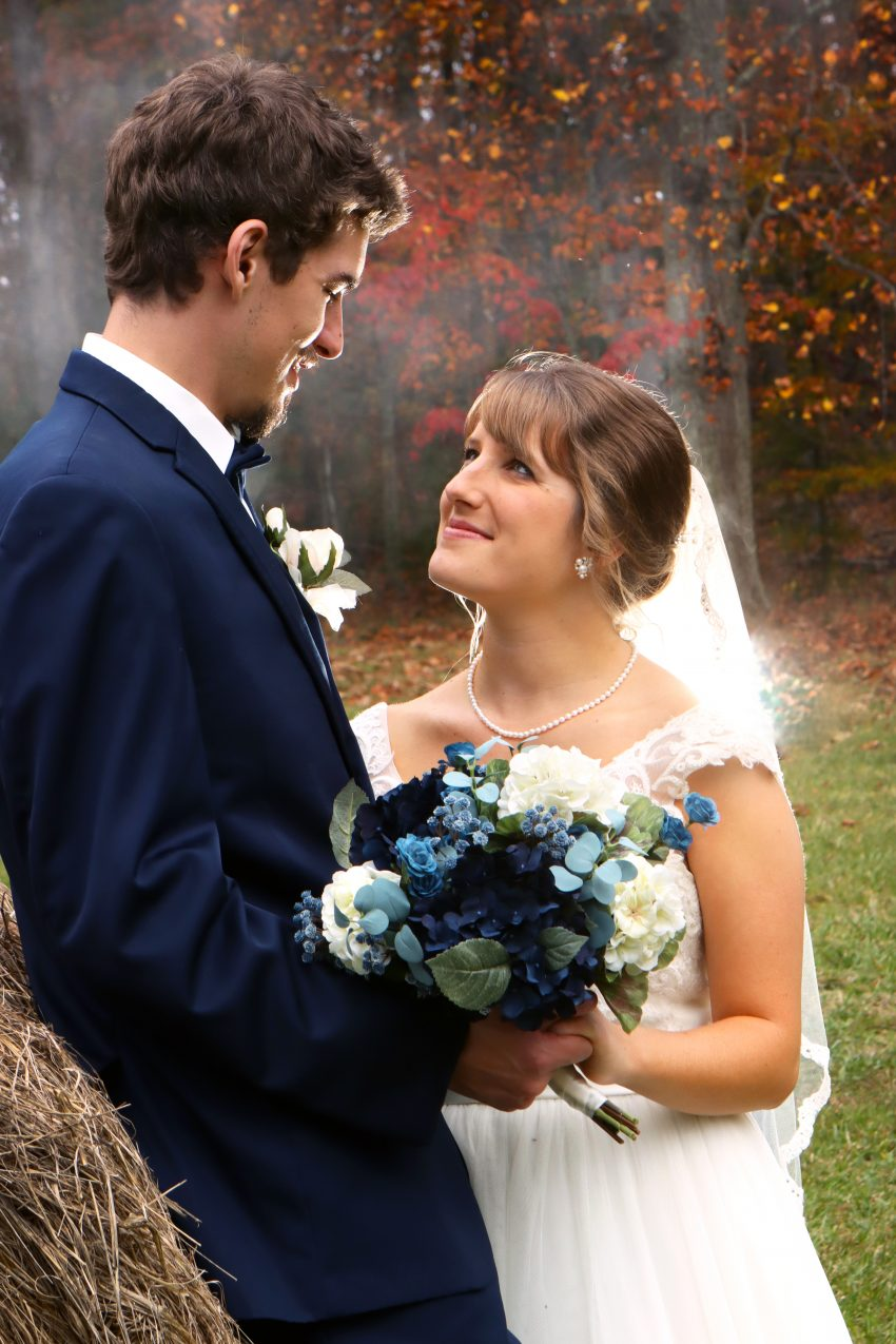 wv country wedding bride and groom portrait by the hay bail