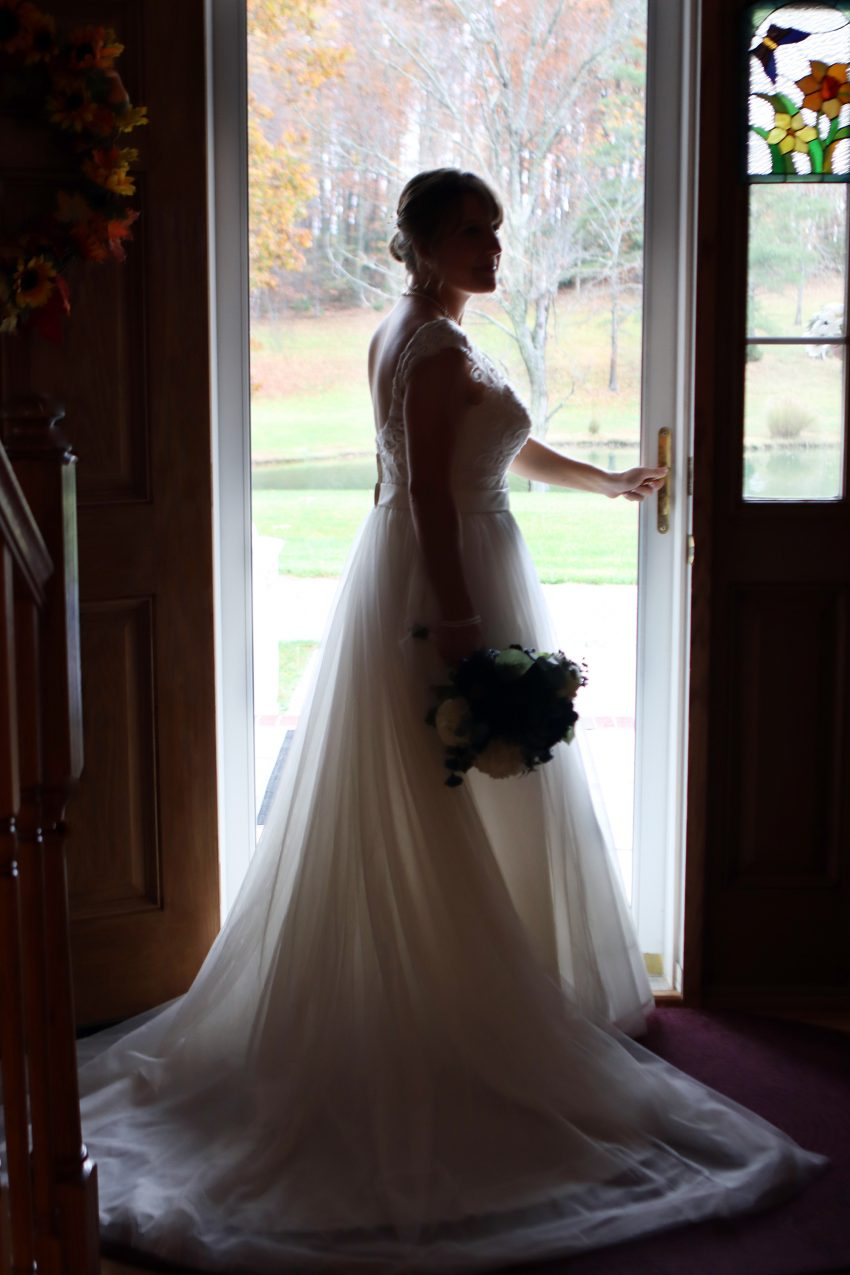 bride silhouette standing in a doorway