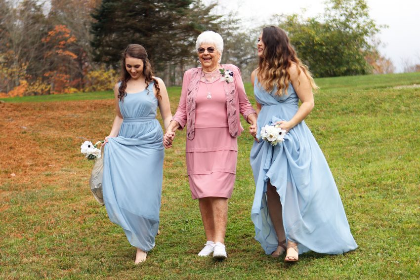 wv country wedding bridesmaids walk with grandma