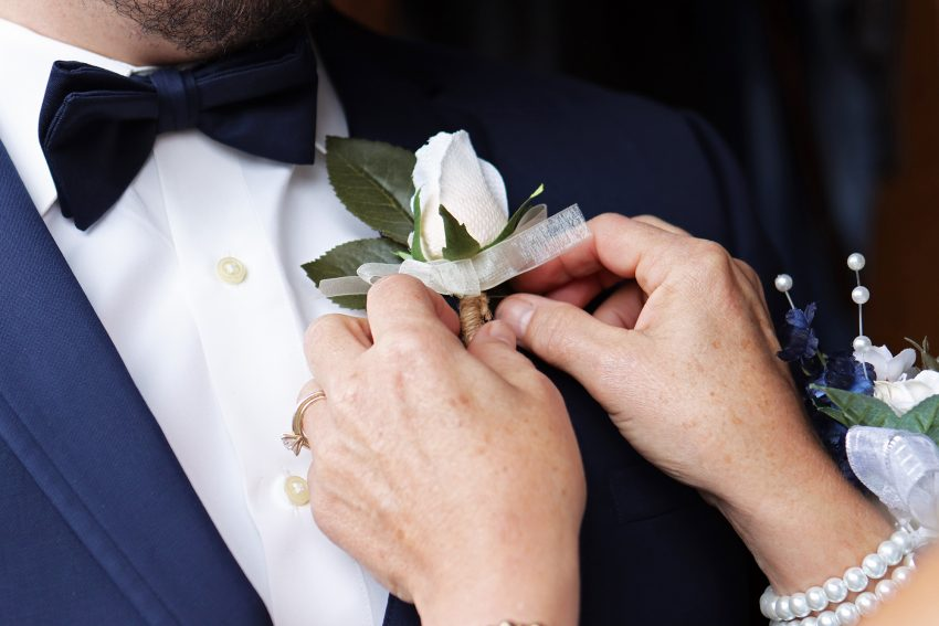 wv country wedding pinning the boutonniere