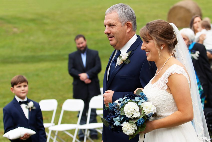 wv country wedding bride and her father walk down the aisle