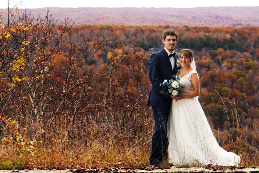 wv country wedding fall colors surround the bride and groom