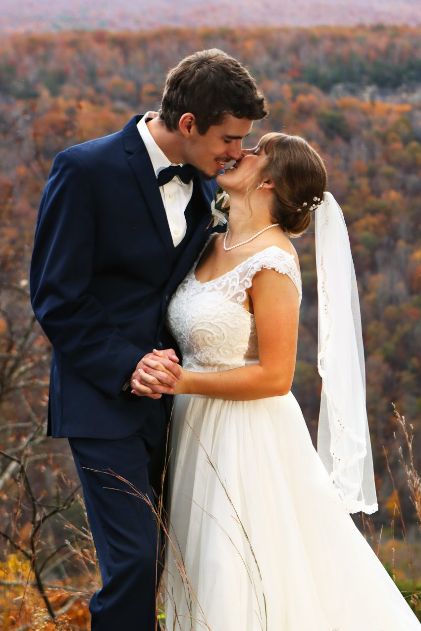 wv country wedding bride and groom kiss in a fall landscape