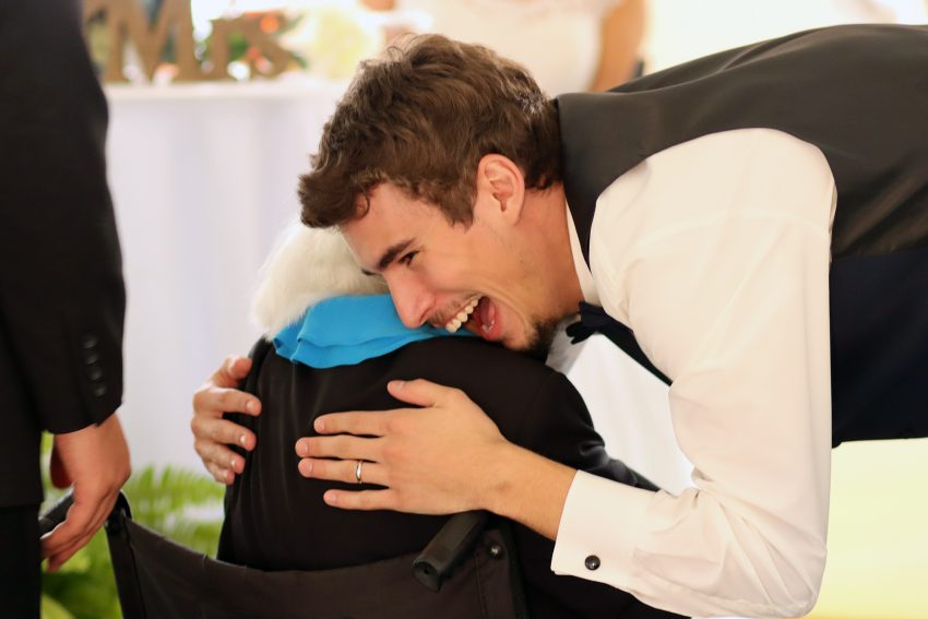 wv wedding groom hugging his grandma