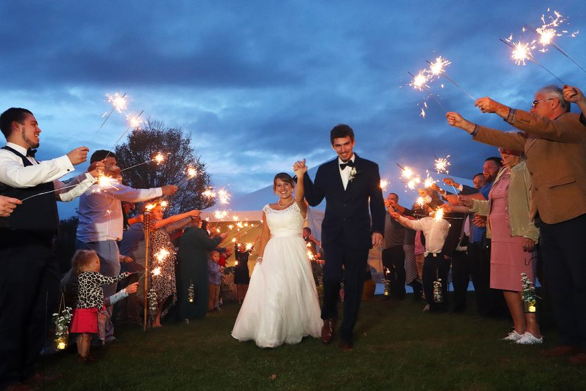 wv country wedding Bride and groom leaving the reception with sparklers